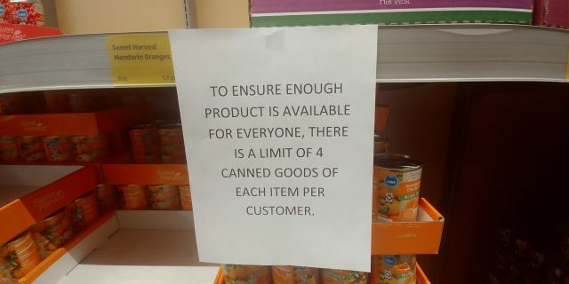 panic buying where stores limit amount of items to be purchased with signs