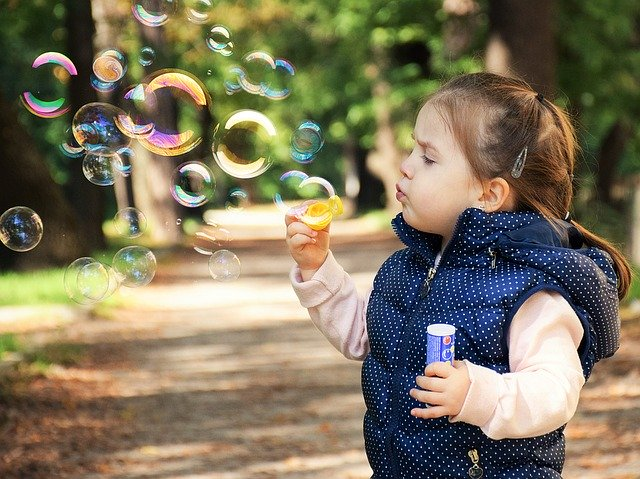 blowing bubbles with a kid